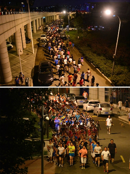 青岛国信体育馆外数千人的暴走团,每晚以灯亮为信号,绕场三周