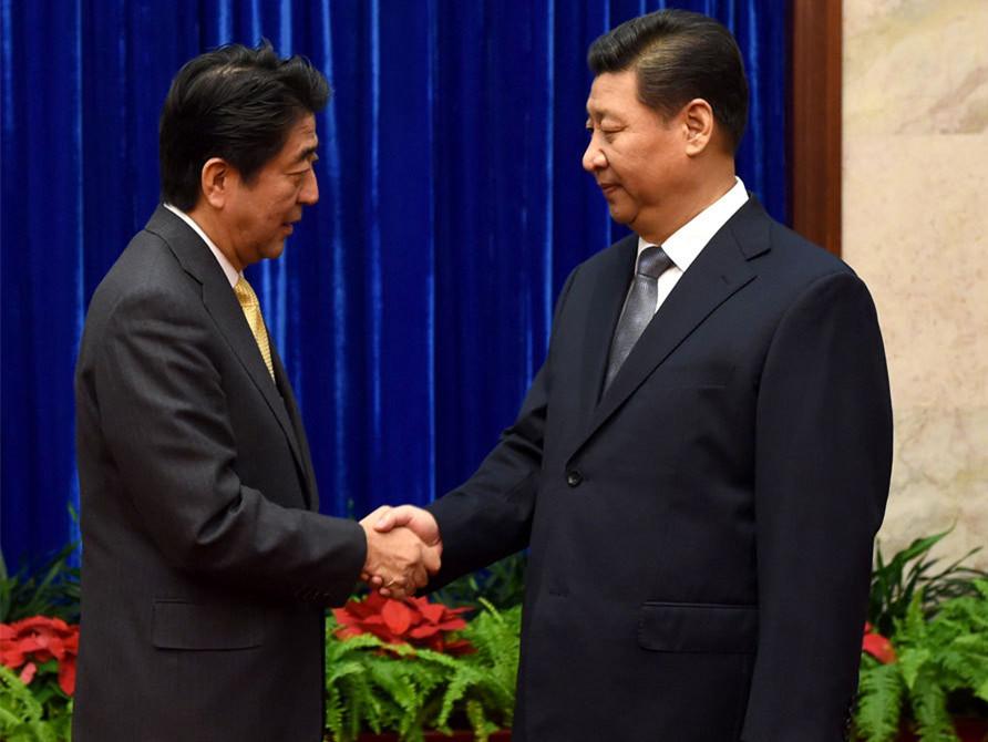 APEC授权发布:习近平会见日本首相安倍晋三