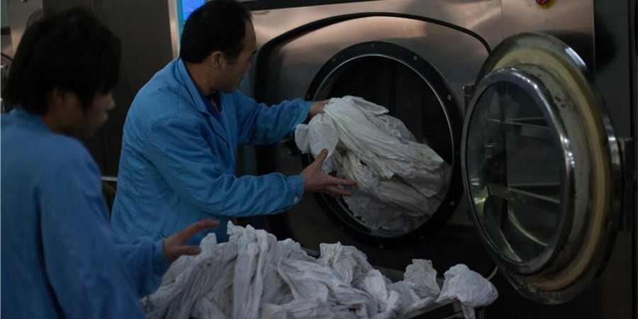 揭秘2015年春运列车卧具洗涤车间