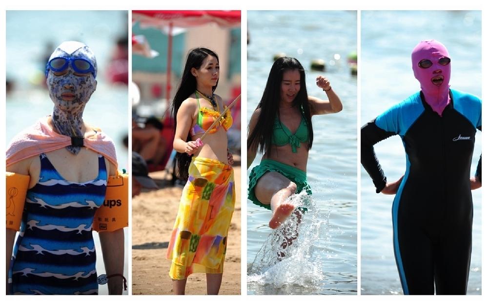 青岛海滩游客扎堆 比基尼美女、脸基尼大妈抢