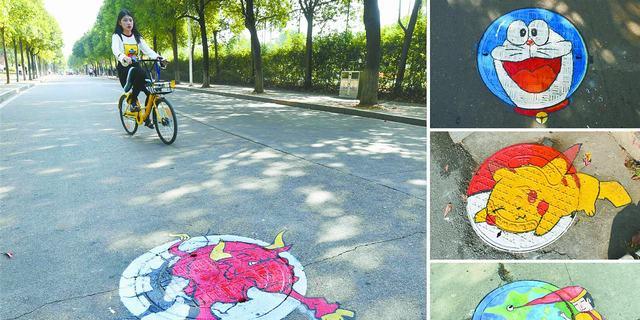湖南农业大学创意井盖画美化校园