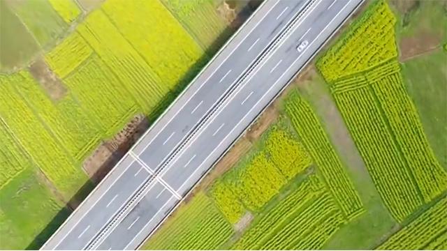 道县:厦蓉高速穿过万亩油菜花