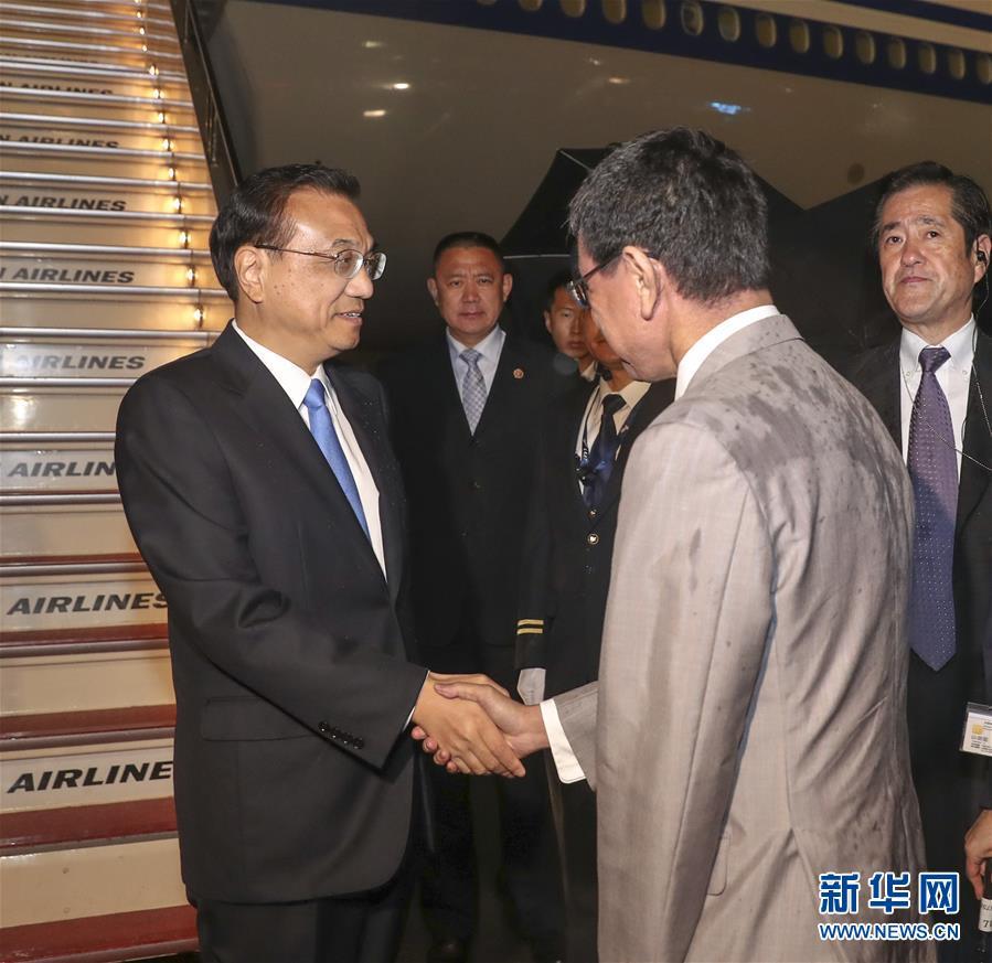 新加坡金沙华人娱乐场:李克强抵达东京出席第七次中日韩领导人会议并对日本进行正式访问