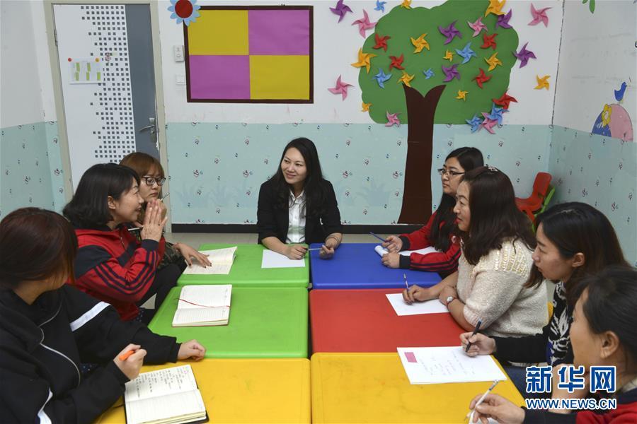 (两会·图片故事)(7)全国人大代表王欣会:让自闭症儿童融入社会生活