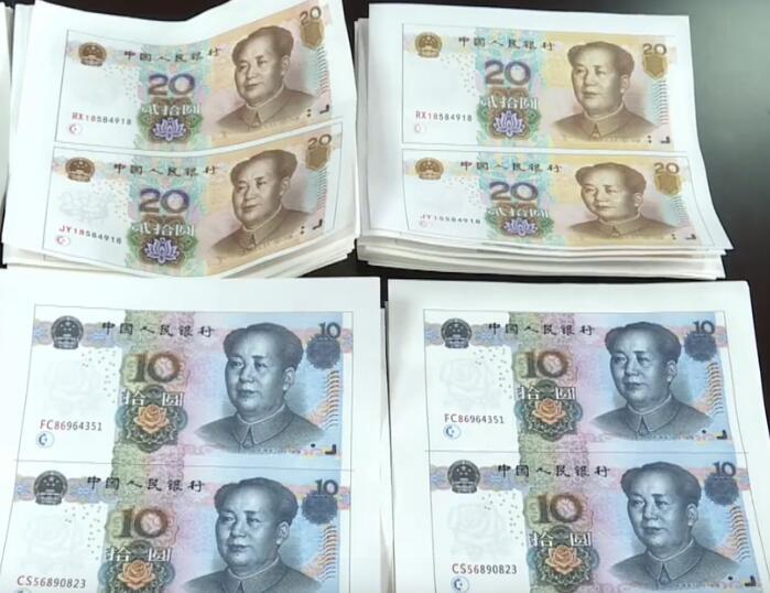 两名男子出租屋内制假钞 被抓时还在不停印刷
